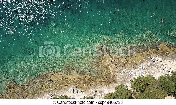 Aerial top down view of a rocky beach of the Adriatic sea. Summer vacation time - csp49465738