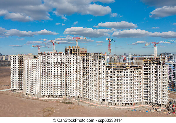 Aerial top view large-scale construction of a residential complex with a view of construction cranes. - csp68333414