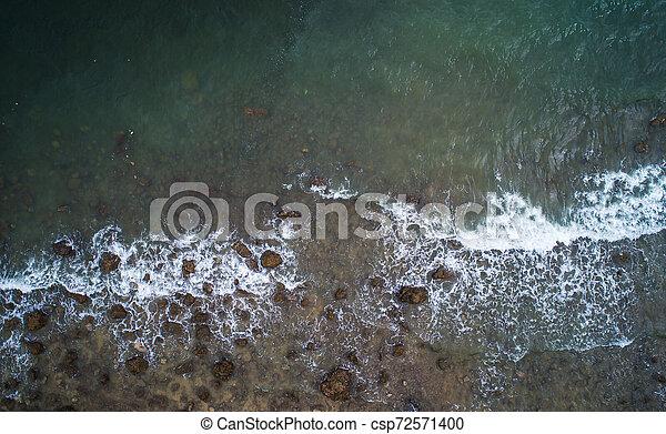 Aerial top view of ocean waves and Rock coast. - csp72571400