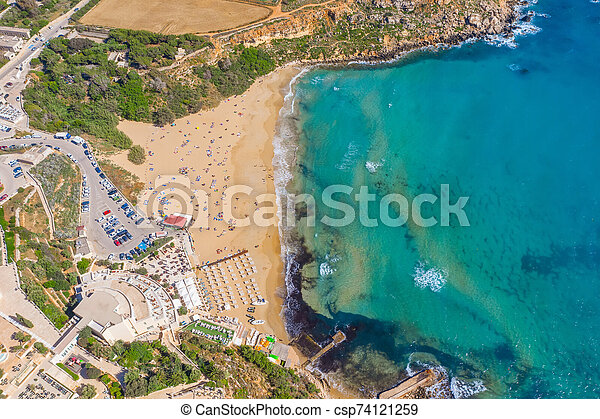 Aerial vew from fying drone view of the wild beach with sunbathers resting people. - csp74121259