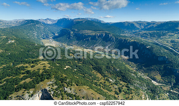 Aerial view Komarnica river canyon and the road to Zabljak - csp52257942