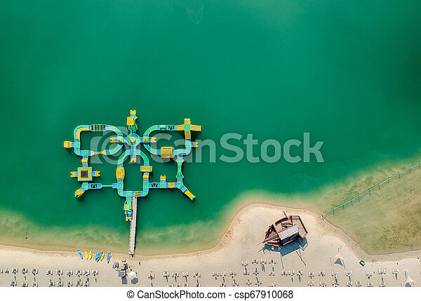 Aerial view of a beach and green water - csp67910068