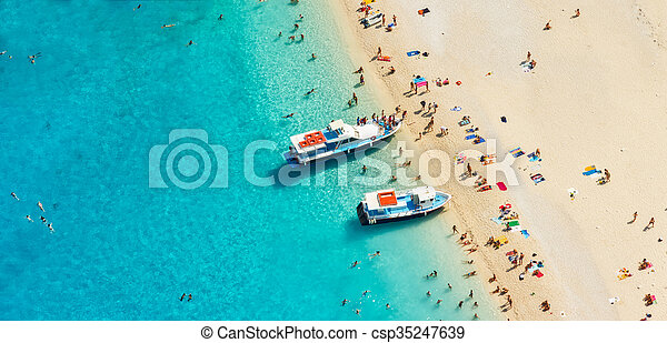 Aerial view of a beach with motorboats and people - csp35247639