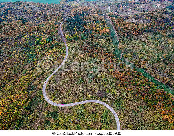 Aerial view of a curly road - csp55805980