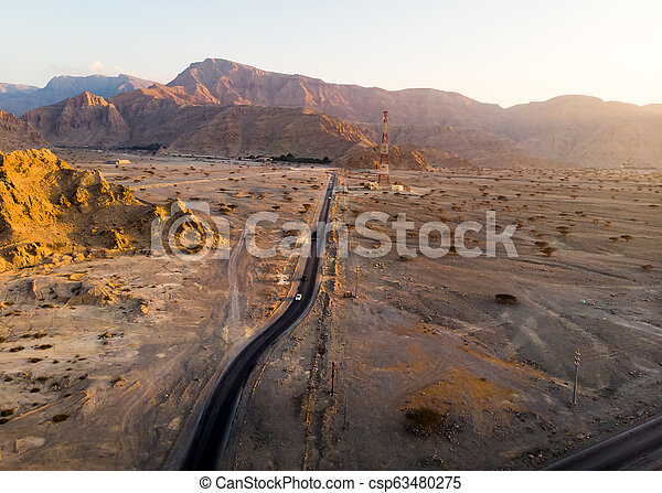 Aerial view of a desert road - csp63480275
