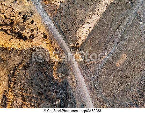Aerial view of a desert road - csp63480288