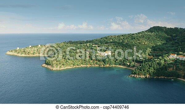 Aerial view of a distant coastal villa, Greece - csp74409746