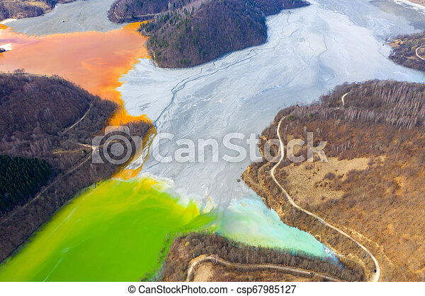 Aerial view of a lake filled with chemical waste water - csp67985127