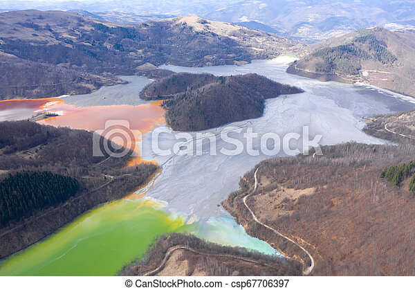 Aerial view of a lake filled with chemical residuals - csp67706397