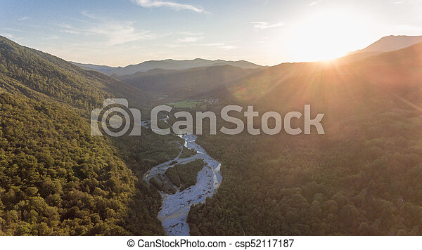 Aerial view of a river valley at sunset. - csp52117187