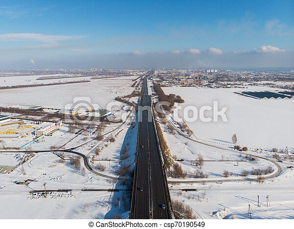 Aerial view of a road in winter landscape - csp70190549