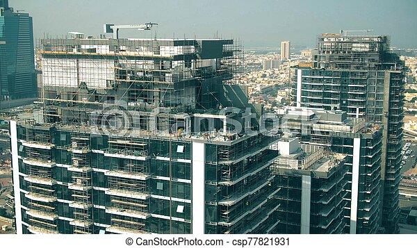 Aerial view of a skyscraper construction site details. Dubai, UAE - csp77821931