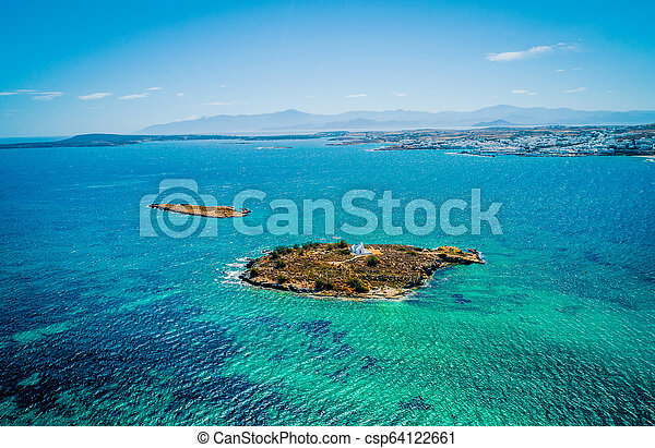 Aerial view of a small island in the sea with a white chapel, Paros - csp64122661