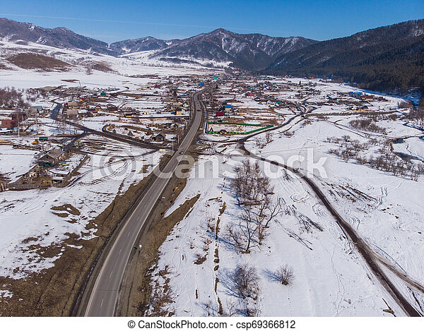 Aerial view of a winter road - csp69366812