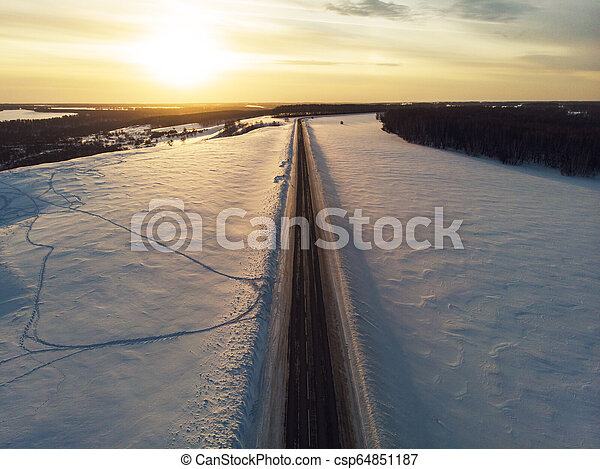 Aerial view of a winter road - csp64851187