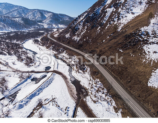 Aerial view of a winter road - csp69930885