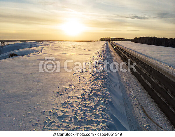 Aerial view of a winter road - csp64851349
