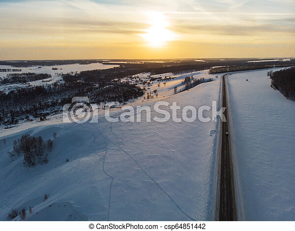 Aerial view of a winter road - csp64851442