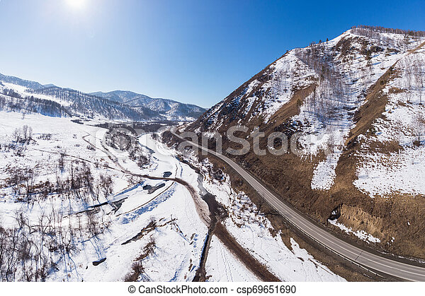Aerial view of a winter road - csp69651690