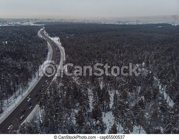 Aerial view of a winter road - csp65500537