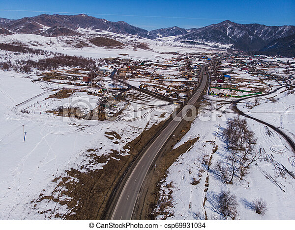 Aerial view of a winter road - csp69931034