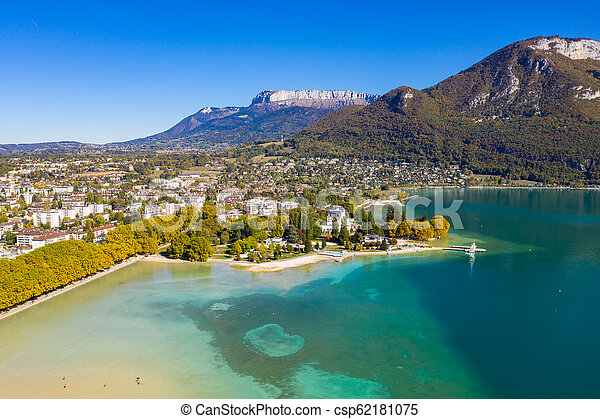 Aerial view of Annecy lake waterfront low tide level due to the drought in France - csp62181075