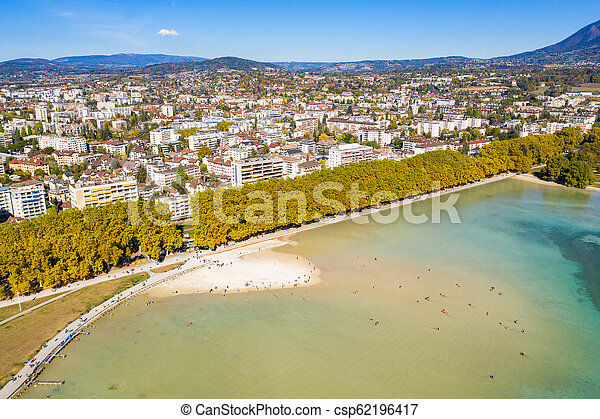 Aerial view of Annecy lake waterfront low tide level due to the drought in France - csp62196417