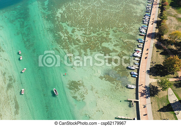 Aerial view of Annecy lake waterfront low tide level due to the drought in France - csp62179967