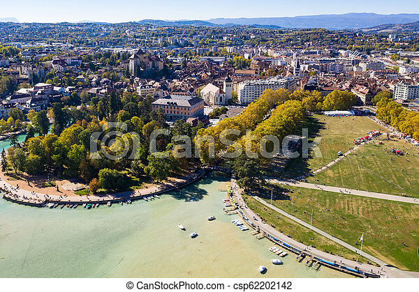 Aerial view of Annecy lake waterfront low tide level due to the drought in France - csp62202142