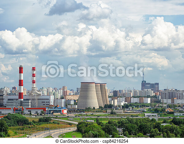Aerial view of chimneys of a power plant, an industrial district in the North of Moscow - csp84216254