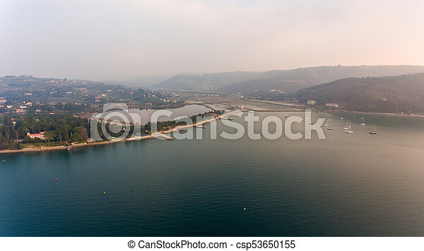 Aerial view of cliffs raising above sea. - csp53650155