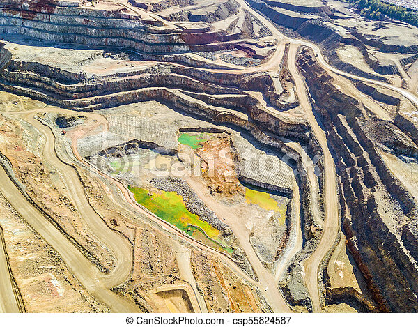 Aerial view of colorful, open pit mine - csp55824587