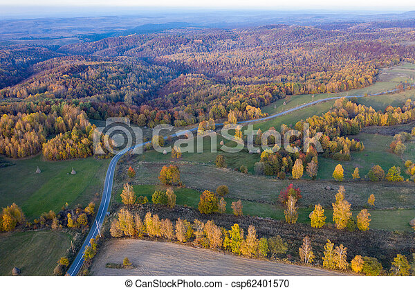 Aerial view of countryside road at autumn - csp62401570