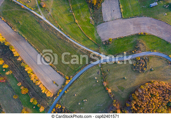 Aerial view of countryside road at autumn - csp62401571