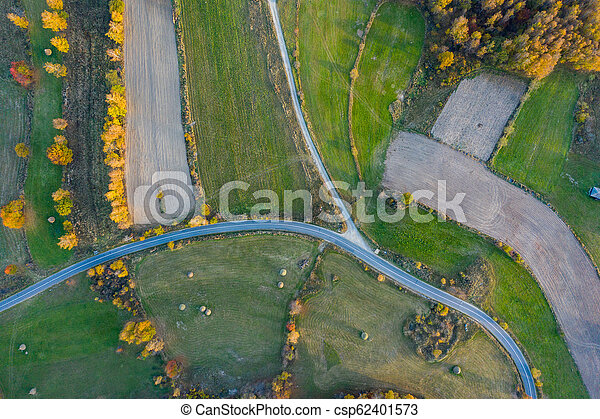 Aerial view of countryside road at autumn - csp62401573