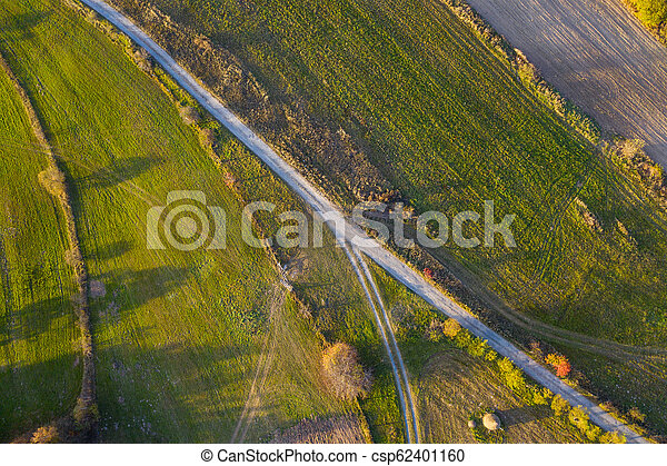 Aerial view of countryside road at autumn - csp62401160