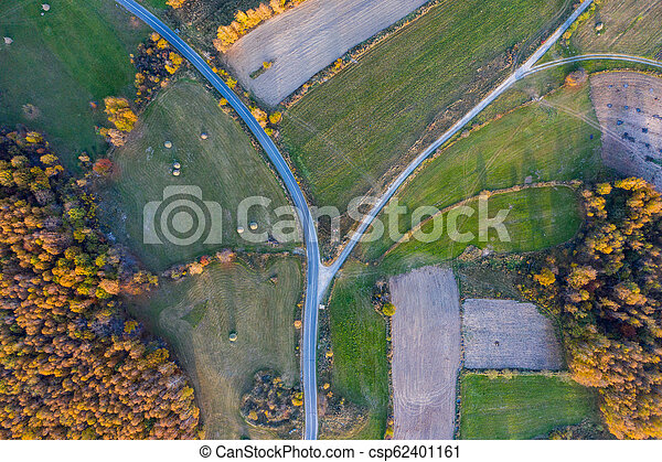 Aerial view of countryside road at autumn - csp62401161