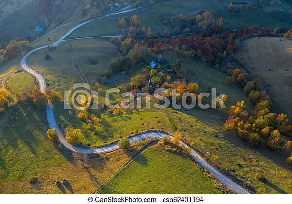 Aerial view of countryside road at autumn - csp62401194