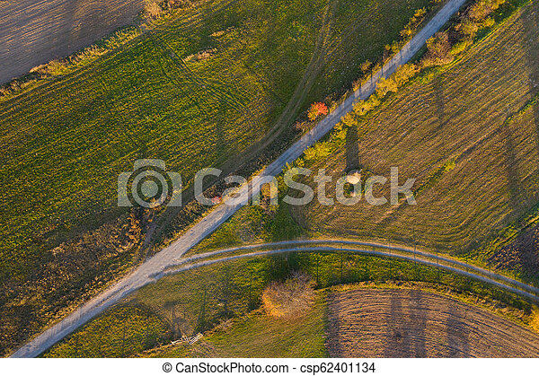 Aerial view of countryside road at autumn - csp62401134