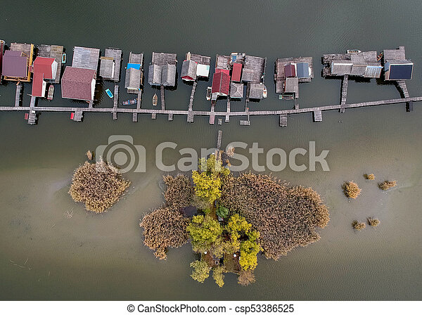 Aerial view of fishing buildings on a lake - csp53386525