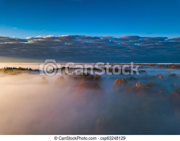 Aerial view of fog in Autumn, Lithuania - csp63248129