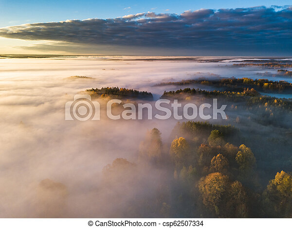 Aerial view of fog in Autumn, Lithuania - csp62507334