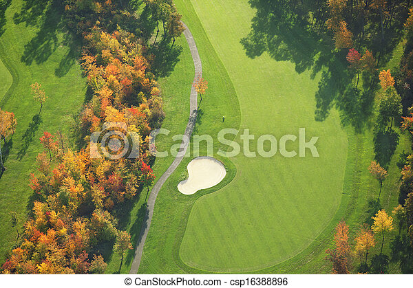 Aerial view of golf course during autumn - csp16388896