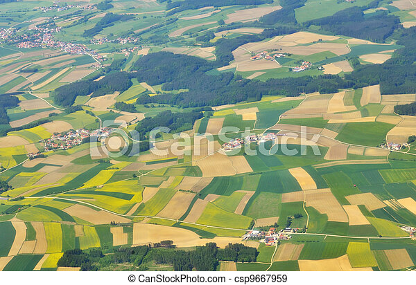 aerial view of green fields above germany - csp9667959