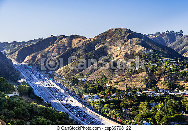 Aerial view of highway 405 with heavy traffic; the hills of Bel Air neighborhood in the background; Los Angeles, California - csp69798122