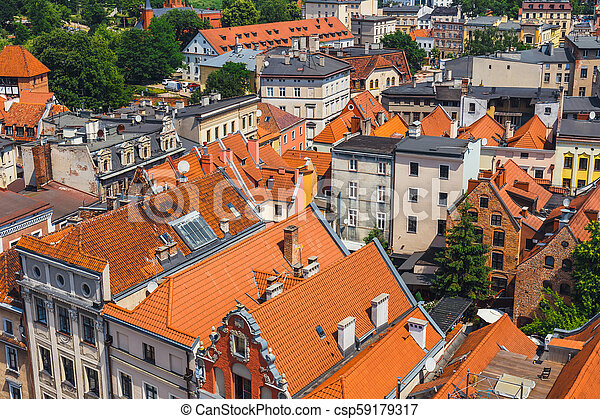 Aerial view of historical buildings and roofs in Polish medieval town Torun, Poland - csp59179317