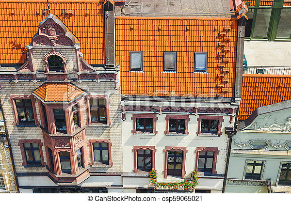 Aerial view of historical buildings and roofs in Polish medieval town Torun, Poland - csp59065021