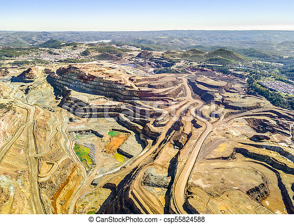 Aerial view of huge, open pit mine - csp55824588