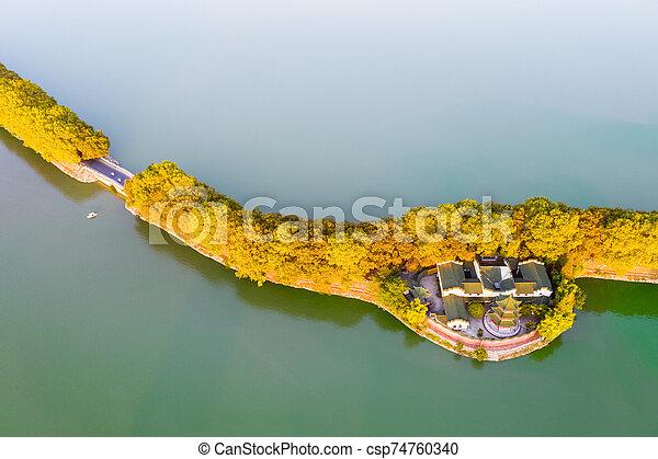 aerial view of lake embankment in autumn - csp74760340
