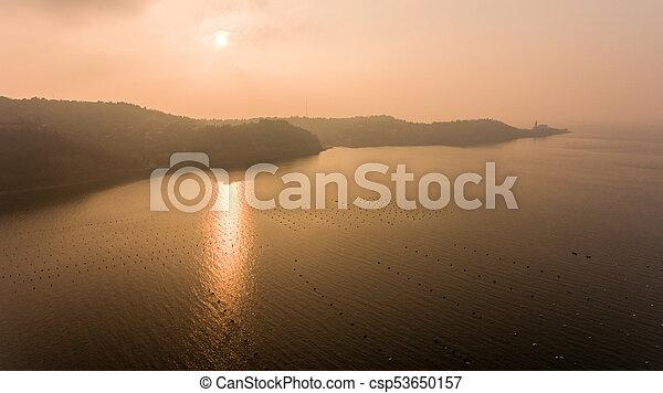Aerial view of mediterranean coastal town at sunset. - csp53650157